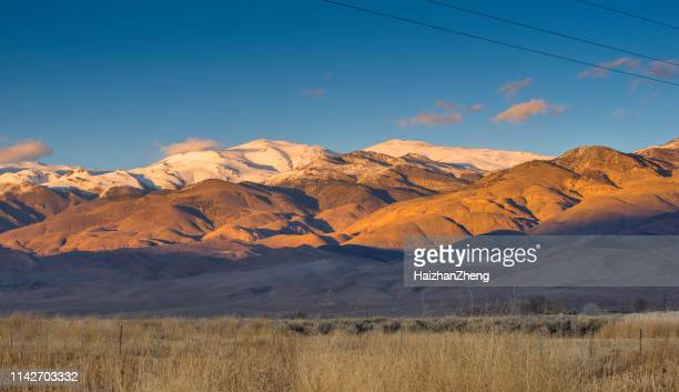 winter landscape around bishop california and the sierra nevada mountains with owens valley farmland - native american reservation stock pictures, royalty-free photos & images