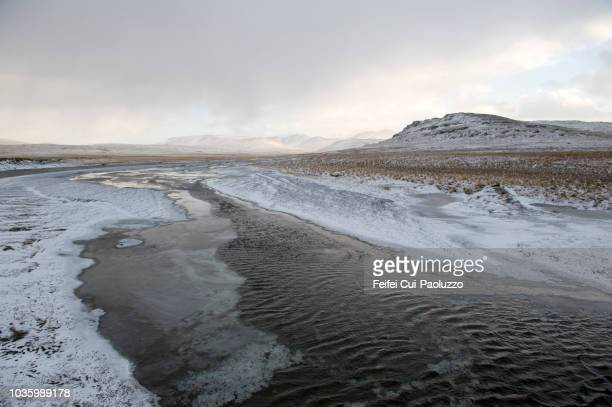 winter landscape near stykkishólmur at snæfellsnes in the west part of iecland - riverbank stock photos and pictures