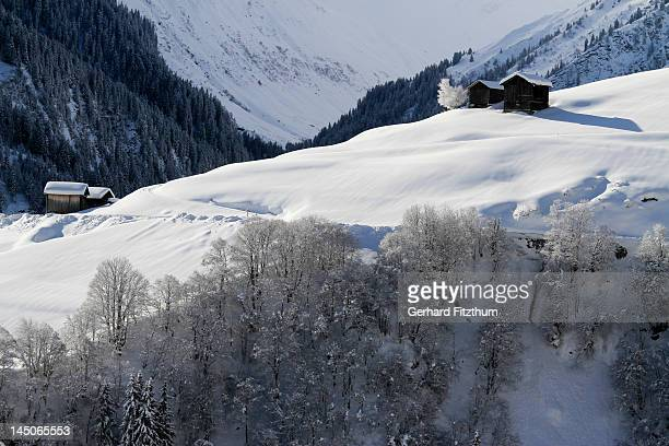 Winter landscape of mountain with log cabins