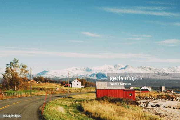Winter landscape of Norway, village, road, mountains with snow