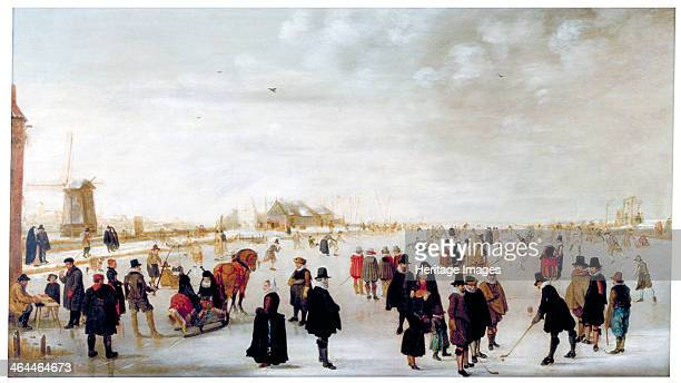 'Winter landscape on the River Ijsel near Kampen' c1615 On the frozen River Ijsel figures are skating playing golf riding horsedrawn sleighs and...