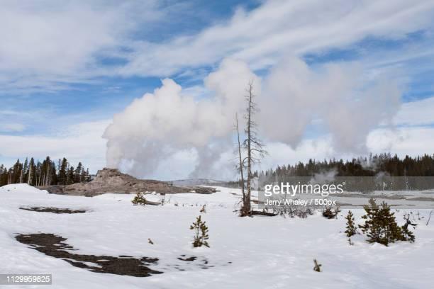 Winter landscape with erupting geyser