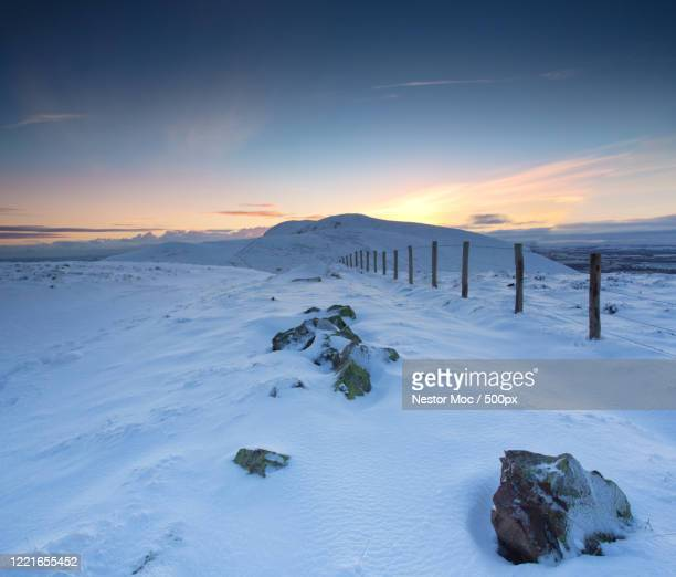 winter landscape with fence and pentland hills at sunrise, edinburgh, scotland, uk - snow stock pictures, royalty-free photos & images