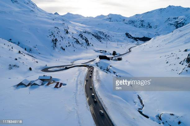 winter landscape with mountain road, aerial view - mountain road stock pictures, royalty-free photos & images