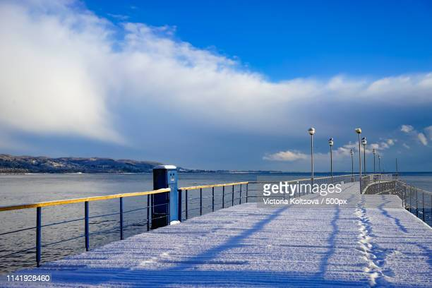 winter landscape with pier in the background of sea and sky - sukhumi stock photos and pictures