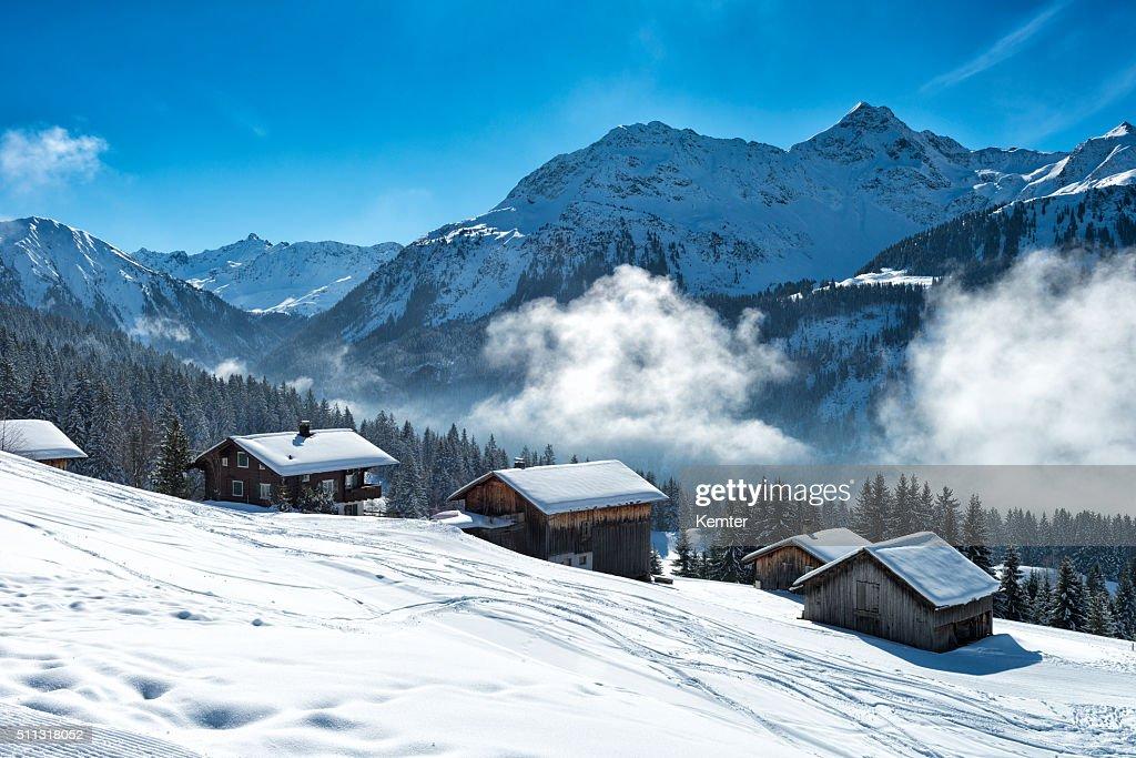winter landscape with ski lodge in austrian alps : Stock Photo