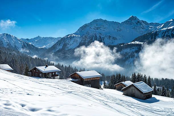 winter landscape with ski lodge in austrian alps