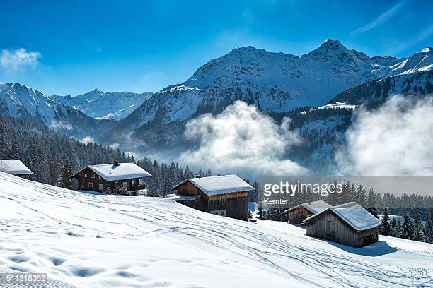 winter landscape with ski lodge in austrian alps - european alps stock photos and pictures
