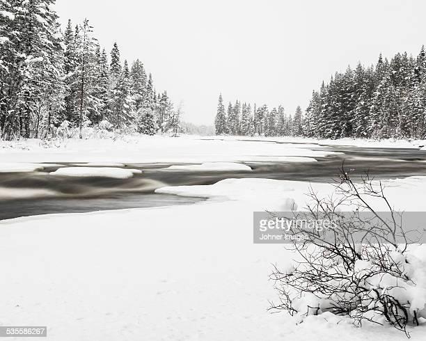 Winter landscape with small river, Osterdalalven, Dalarna, Sweden