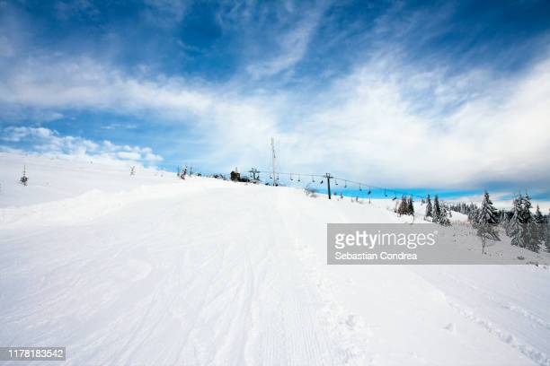 winter landscape with the resort ski and forest, blue sky, ski time. - ski resort stock pictures, royalty-free photos & images
