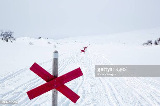 Winter landscape with trail markings