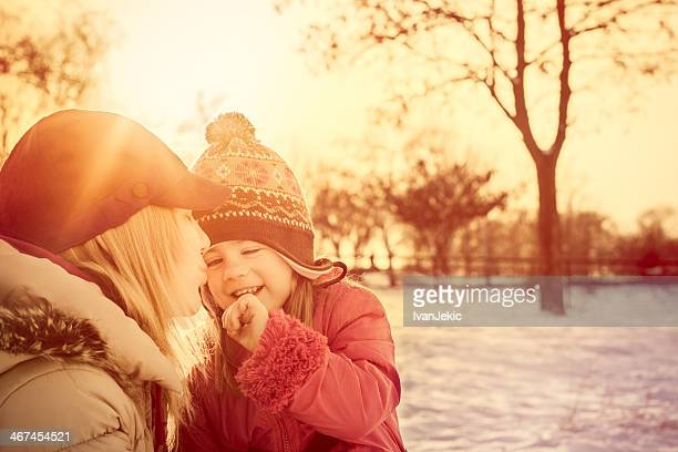 Winter magic with mother and daughter