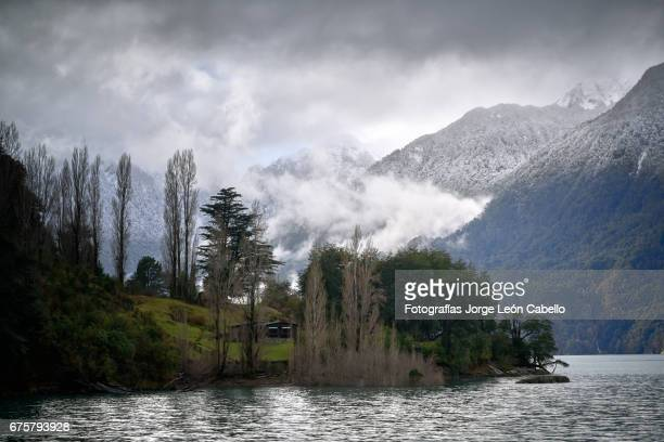 winter mood over the shores of lake todos los santos during de andean lake crossing - azul turquesa stock pictures, royalty-free photos & images