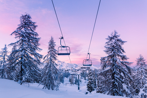 Winter mountains panorama with ski slopes and ski lifts 909307378