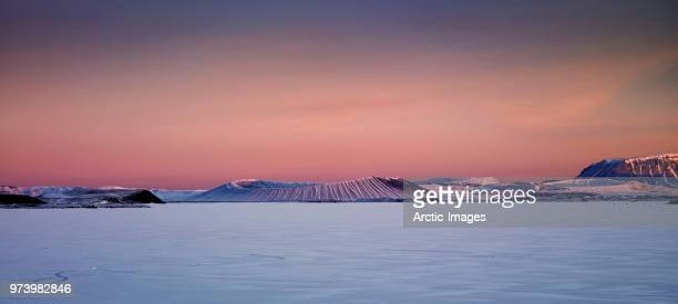 winter, mt. hverfjall and lake myvatn, northern iceland - images photos et images de collection