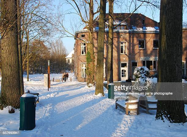 winter near rustic water mill - chilly bin stock photos and pictures