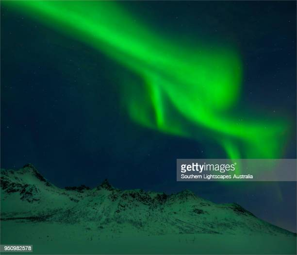 Winter night skies over Kvaloya with the Aurora Borealis, Arctic circle, Norway