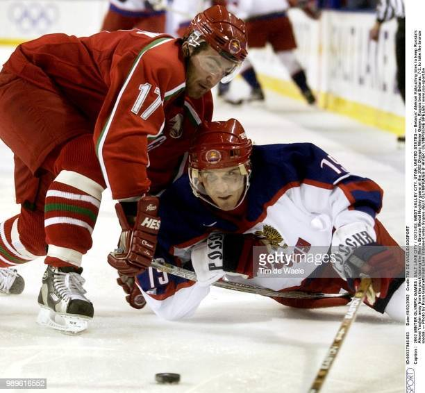Salt Lake City 02/23/02 West Valley City Utah United States Belarus' Aleksei Kalyuzhny Tries To Keep Russia'S Alexei Yashin Away From The Puck During...
