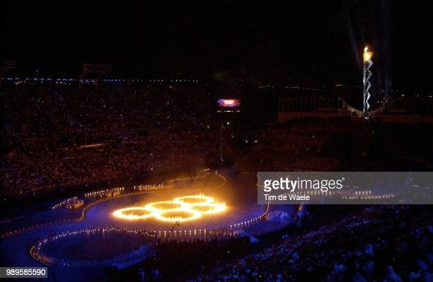 Salt Lake City 02/8/2002 Salt Lake City Utah United States As The Olympic Cauldron Burns Bright In The Background Flaming Olympic Rings Close The...