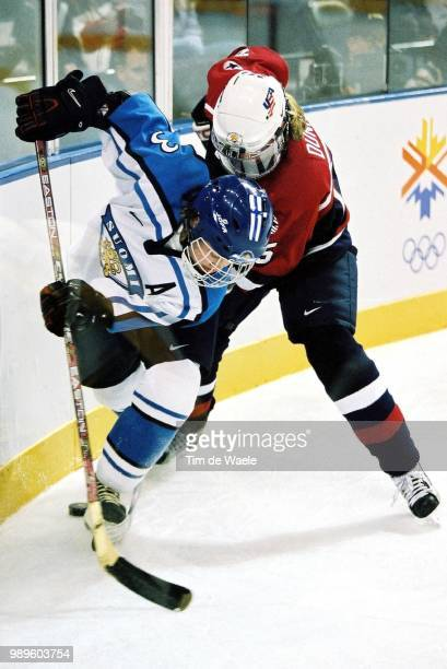 Salt Lake City 2/16/02 West Valley City Utah United States Us Player Battles Against Finland'S Emma Laaksonen In Their Women'S Ice Hockey Game During...