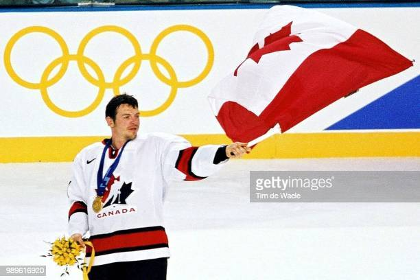 Salt Lake City 2/24/02 West Valley City Utah United States Canada Men'S Hockey Player Mario Lemieux Parades The Flag Of Canada Around The Rink After...