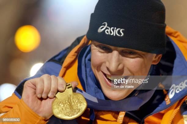 Salt Lake City 2/9/02 Salt Lake City Utah United States Jochem Uytdehaage Of The Netherlands Displays His Gold Medal Won In The 5000Meter Speed...