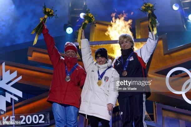 Salt Lake City 2/9/02 Salt Lake City Utah United States Women'S 15Km Free CrossCountry Gold Medalist Stefania Belmondo Of Italy Is Flanked By Silver...