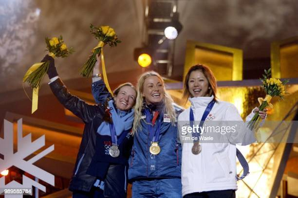 Salt Lake City 2/9/02 Salt Lake City Utah United States Women'S Moguls Gold Medalist Kari Traa Of Norway Is Flanked By Silver Medalist Shannon Bahrke...