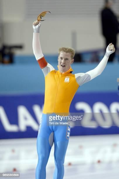 Salt Lake City 2/9/2002 Kearns Utah United States Jochem Uytdehaage Of The Netherlands Celebrates After Skating To A Gold Medal And A New World...