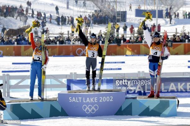 Salt Lake City Joie Stefani Belmondo Celebrates Her Gold Medal Victory In The Women'S 15Km Cross Country Skiing She Is Flanked By Silver Medalist...
