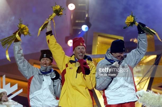 Salt Lake City Men'S 30Km Free CrossCountry Gold Medalist Johann Muehlegg Of Spain Is Flanked By Silver Medalist Christian Hoffmann Of Austria And...
