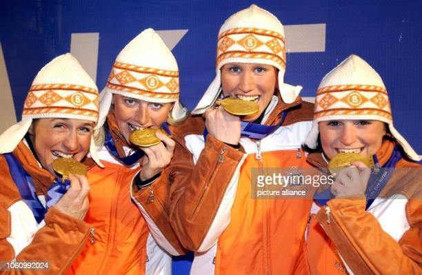 The gold medal winners of the Biathlon Relay Women Uschi Disl Karin Apel Kati Wilhelm und Andrea Henkel are radiantly presenting their goldmedals at...