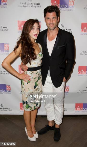 Winter Olympics Ice Dancing gold medalist Meryl Davis and professional dancer Maksim Chmerkovskly attend the 2014 Woman Of The World Luncheon at Four...