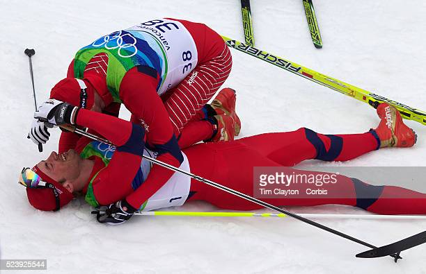 Winter Olympics, Vancouver, 2010 Petter Northug, Norway, Winning the Gold Meda is congratulated by team mate Odd-Bjoern Huelmeset in the Cross...