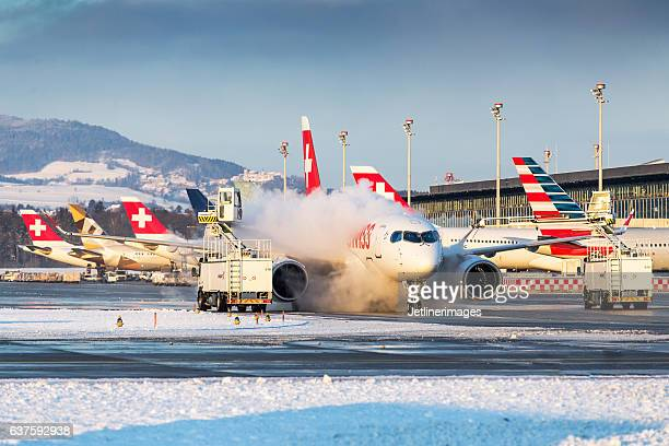 winter operations at zurich airport - stranded stock photos and pictures