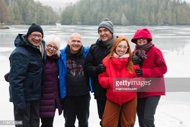 "winter outdoors family portrait by a lake. - ""martine doucet"" or martinedoucet stock pictures, royalty-free photos & images"