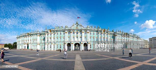 winter palace panoramic at sunny day, st. petersburg, russia - winter palace st. petersburg stock photos and pictures