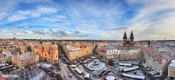 Winter panorama of Prague old town square with Christmas market.
