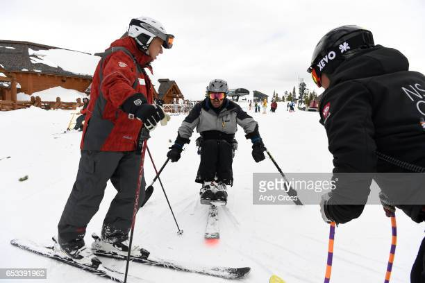 Winter Park Ski resort President and CEO Gary DeFrange left talks with competition skier Michael Murphy center and Scott Olson head race coach for...
