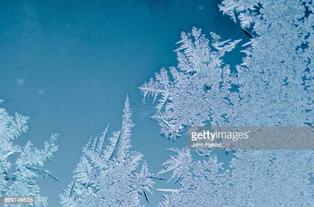 winter patterns - frost on window - frost stock pictures, royalty-free photos & images