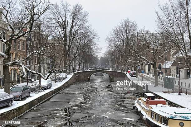 CONTENT] Winter photo of a frozen canal in Amsterdam