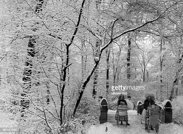 Winter pictures Nannies or nurses from the Spreewald Region with prams in the snowy Tiergarten park Berlin undated probably 1910 Published by...