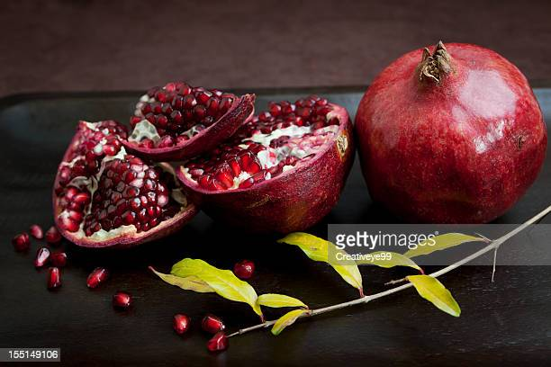 winter pomegranates - pomegranate stock pictures, royalty-free photos & images