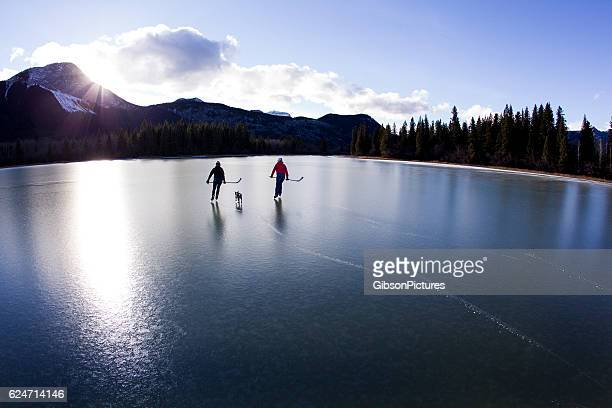 winter pond ice skate - traditionally canadian stock pictures, royalty-free photos & images