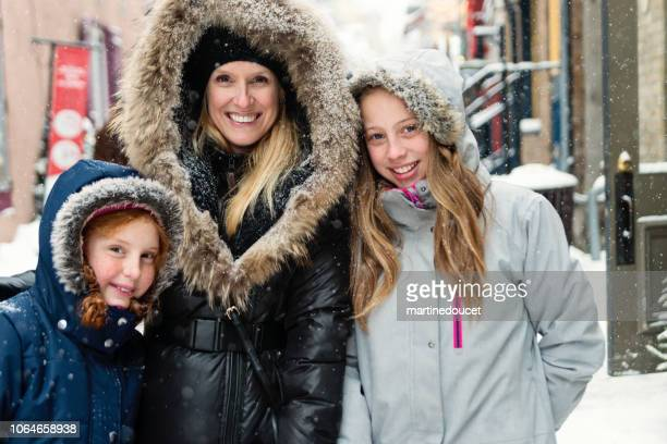 Winter portrait for mother and preteen girls.