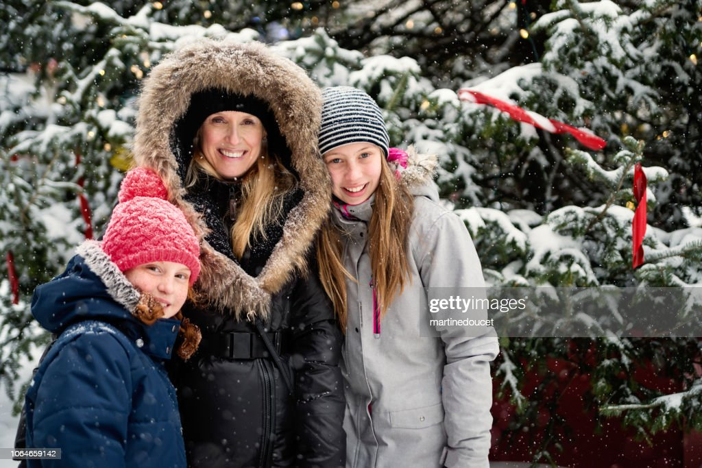 Winter portrait for mother and preteen girls. : Stock Photo