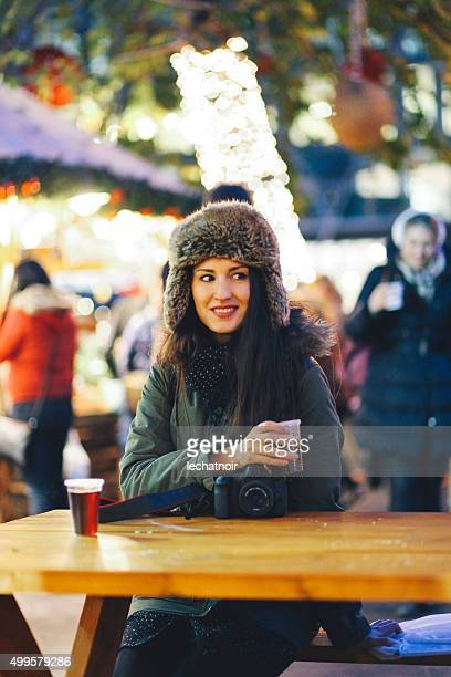winter portrait of a smiling young woman in town - girls flashing camera stock pictures, royalty-free photos & images