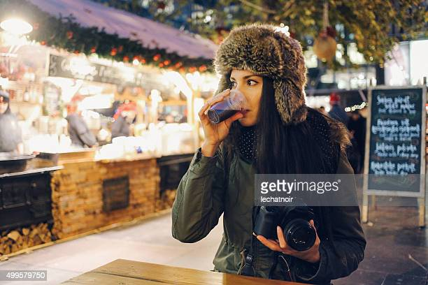 winter portrait of a smiling young woman photographer - girls flashing camera stock pictures, royalty-free photos & images