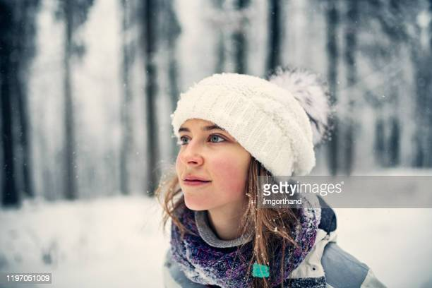 winter portrait of a teenage girl - knit hat stock pictures, royalty-free photos & images