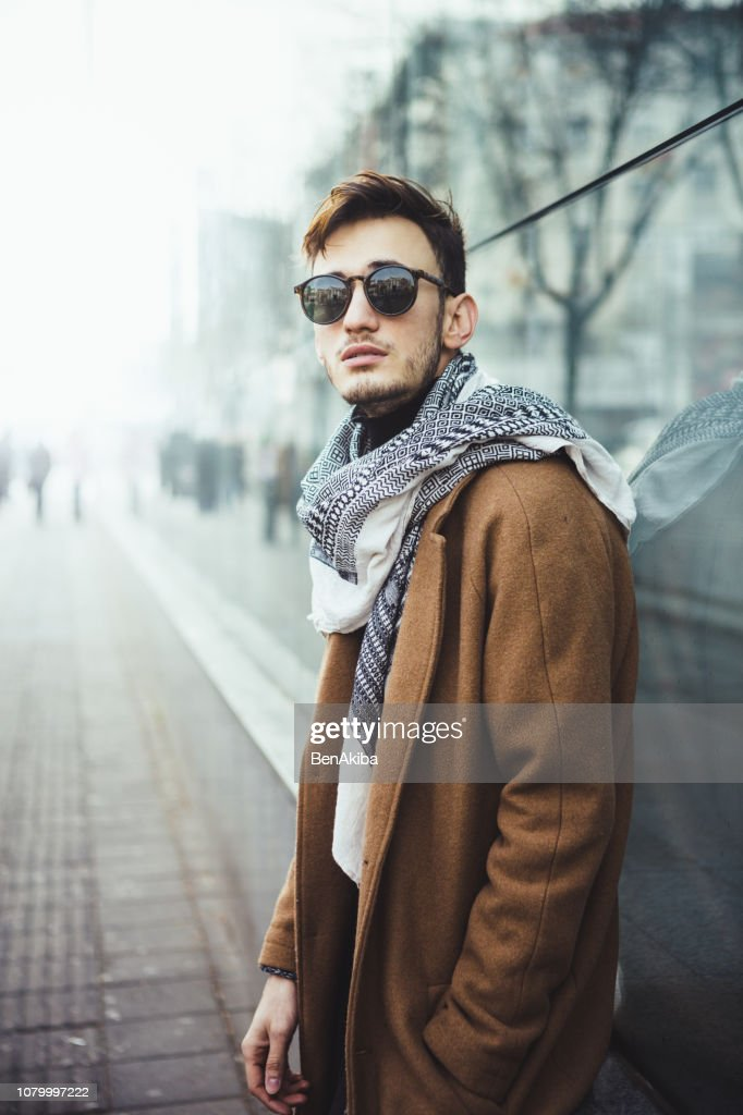 Winter portrait of a young man in the city : Stock Photo